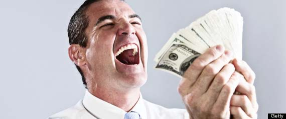 Overjoyed businessman with big bundle of dollars